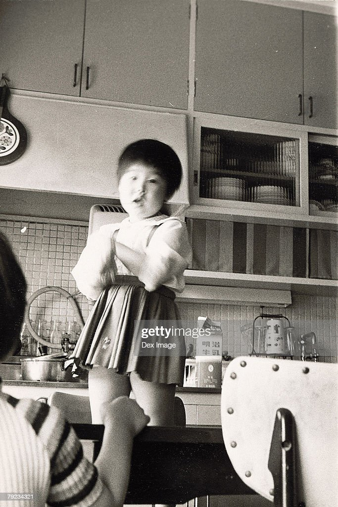 Portrait of a girl at kitchen : Stock Photo