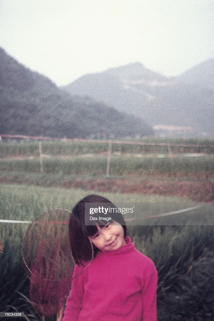 Portrait of a girl at vegetation : Stock Photo