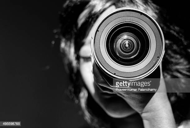 Portrait of a girl child with a lens