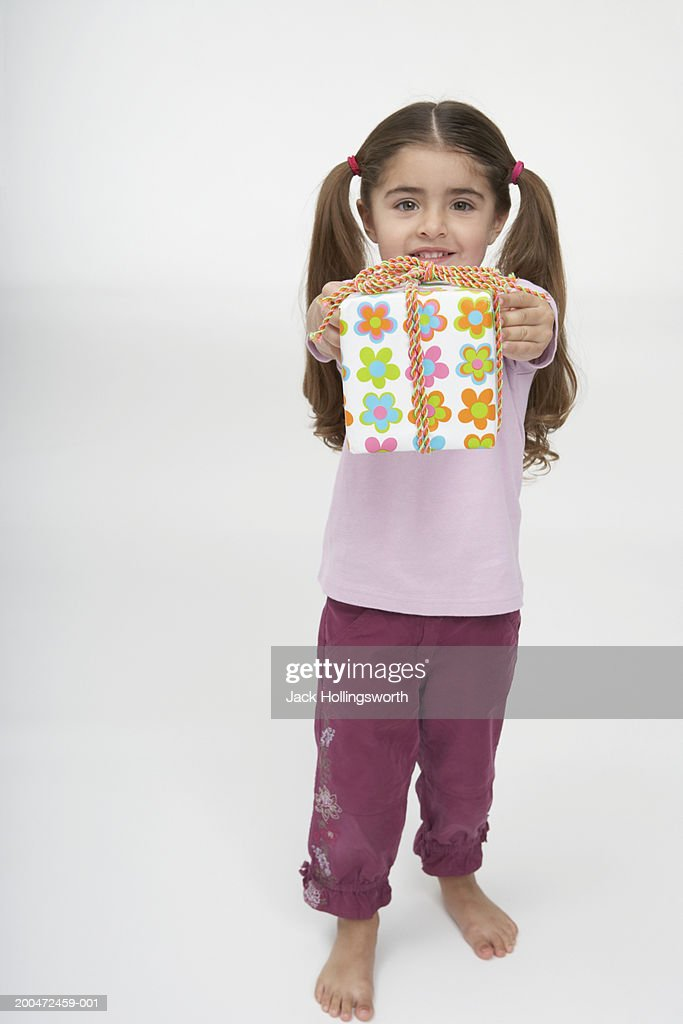 Portrait of a girl holding a gift : Stock Photo