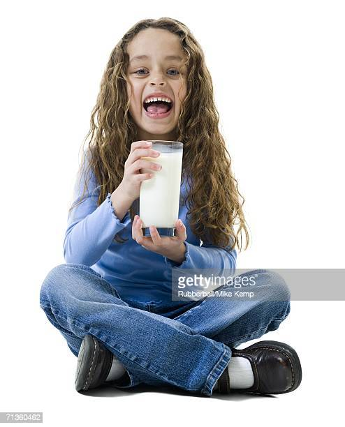 Portrait of a girl holding a glass of milk