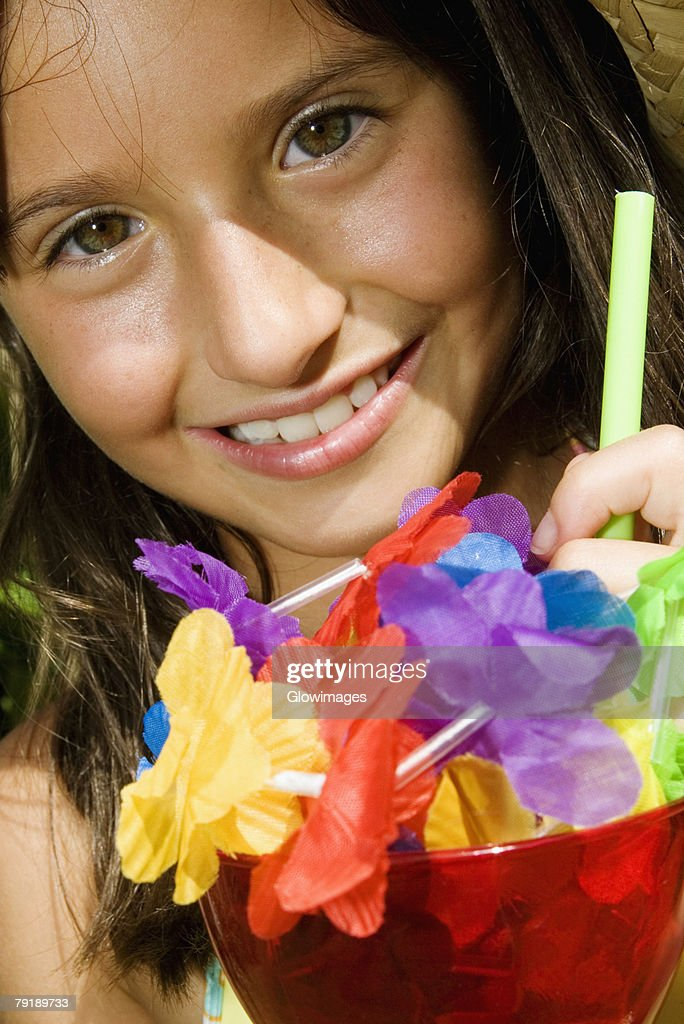 Portrait of a girl holding a glass of mocktail : Foto de stock