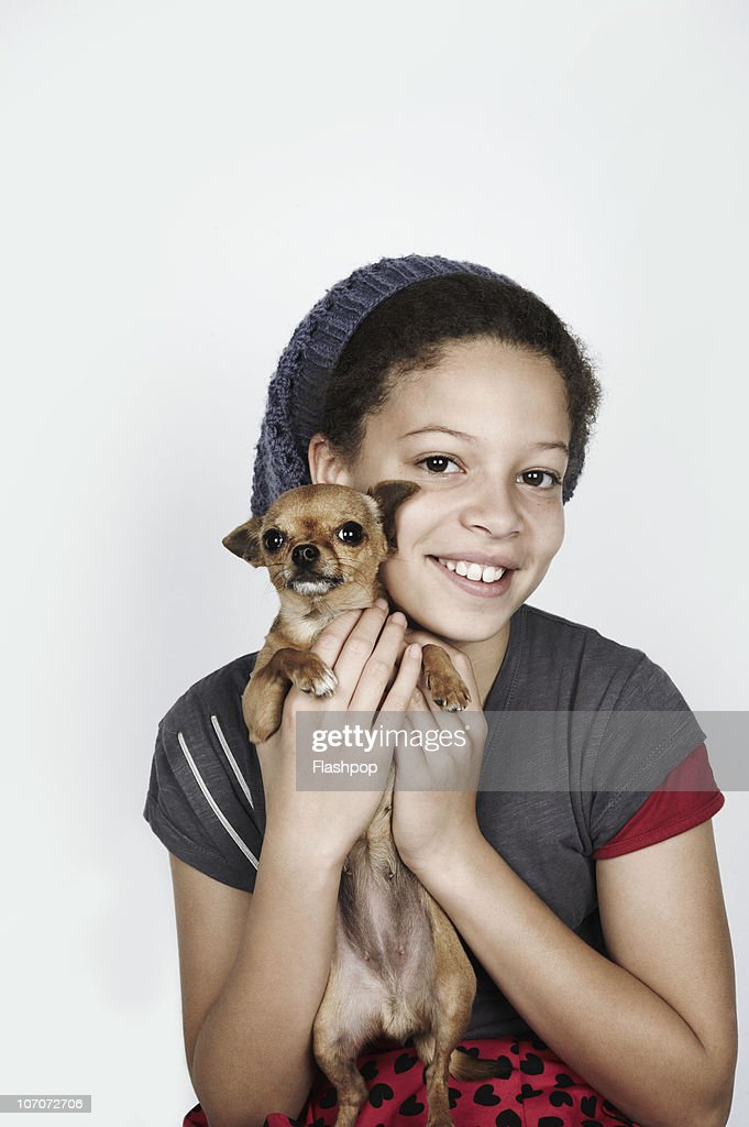 Portrait of a girl holding her pet dog : Stock Photo