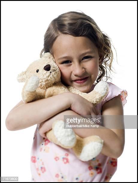 Portrait of a girl hugging a teddy bear