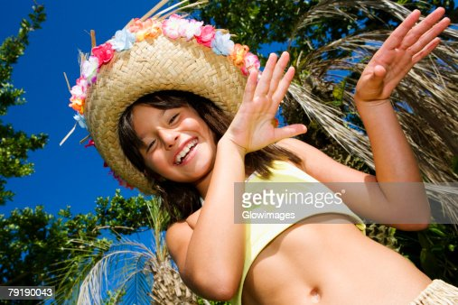 Portrait of a girl hula dancing and smiling : Foto de stock