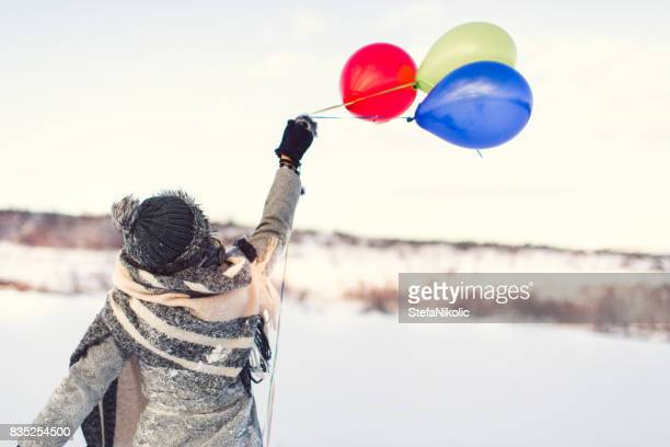Portrait of a girl in love with balloon winter