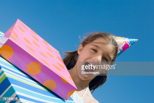 Portrait of a girl laughing with birthday presents : Stock Photo