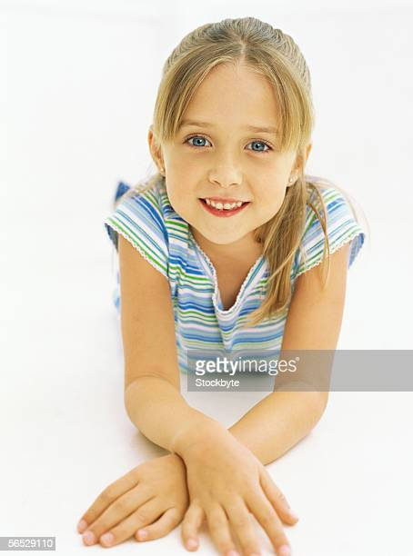 portrait of a girl lying and smiling