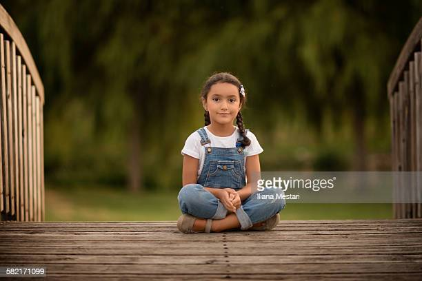 Portrait of a girl on a bridge