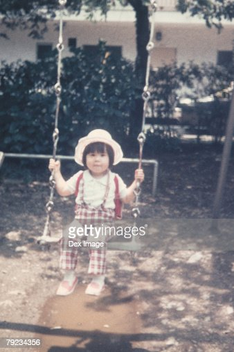 Portrait of a girl on a swing : Stock Photo