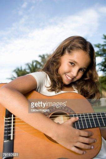 Portrait of a girl playing a guitar : Foto de stock