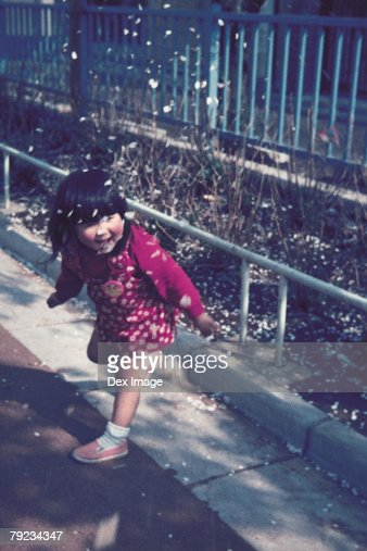 Portrait of a girl playing at passage way : Stock Photo