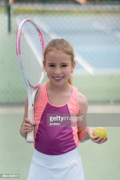 Portrait of a girl playing tennis outdoors