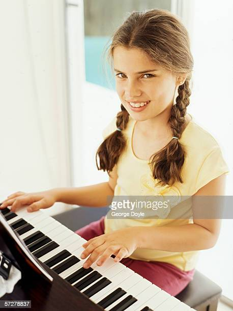 Portrait of a girl playing the piano