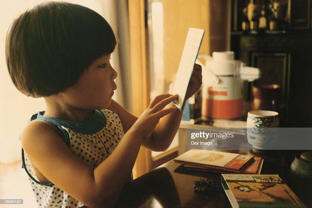 Portrait of a girl reading books : Stock Photo