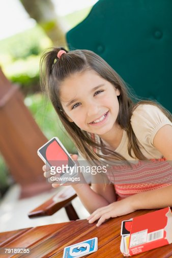 Portrait of a girl showing playing cards and smiling : Foto de stock