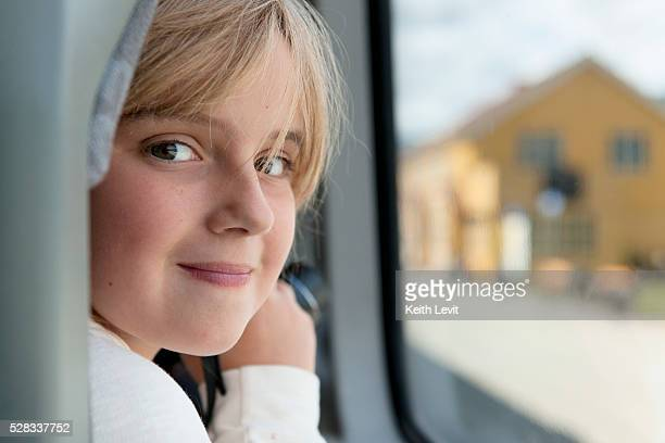 Portrait of a girl sitting by the window; highlands norway