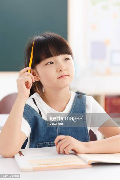 Portrait of a girl sitting in classroom