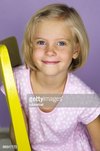 Portrait of a girl sitting on a chair : Stock Photo