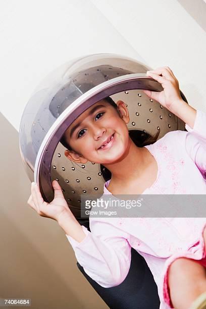 Portrait of a girl sitting under a hair dryer