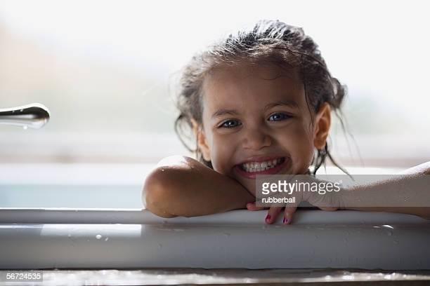 Portrait of a girl smiling in a bathtub