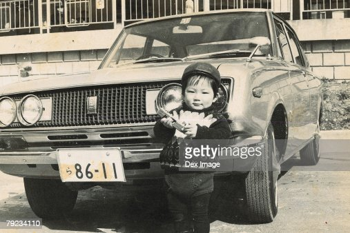 Portrait of a girl standing in front of car : Stock Photo