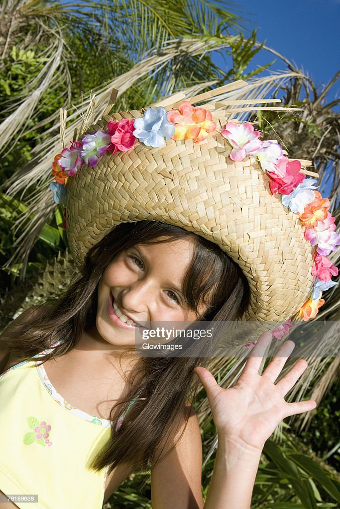 Portrait of a girl wearing a straw hat and dancing : Foto de stock