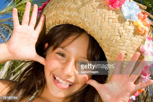 Portrait of a girl wearing a straw hat and sticking her tongue out : Foto de stock