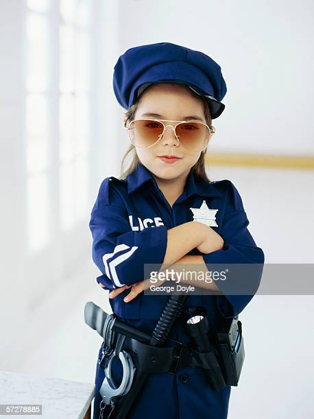 Portrait of a girl wearing sunglasses and pretending to be a policewoman