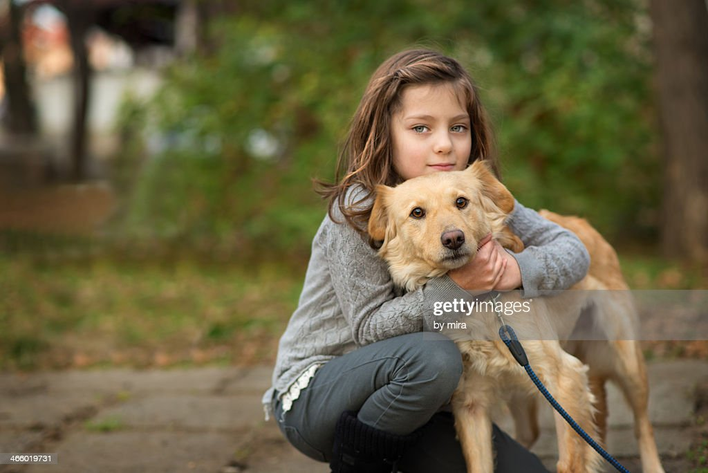 portrait of a girl with a dog : Stock Photo