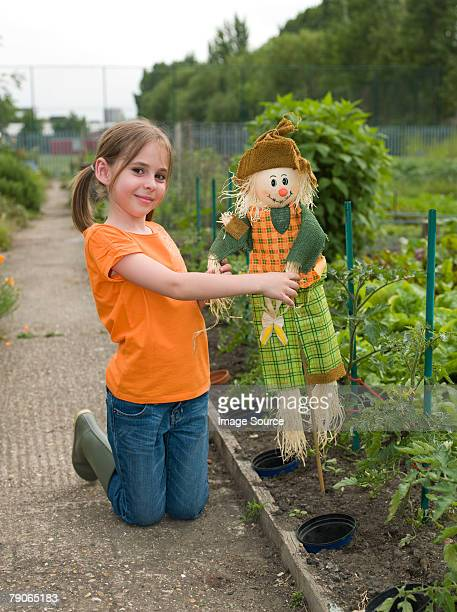 Portrait of a girl with a scarecrow