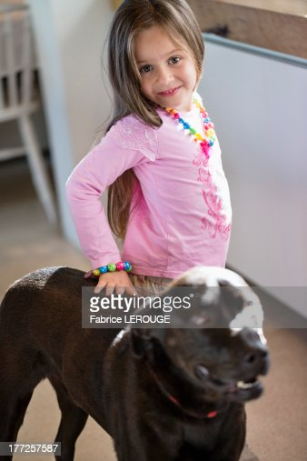 Portrait of a girl with her dog at home : Stock Photo