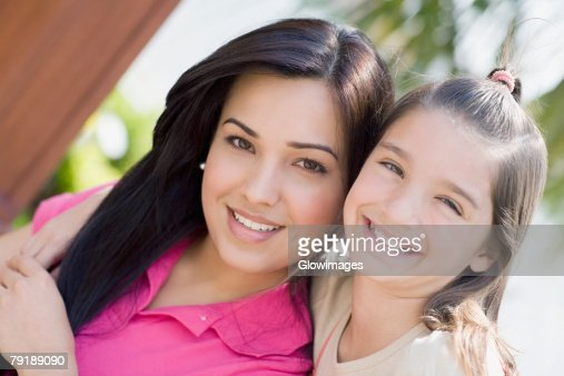 Portrait of a girl with her mother smiling : Stock Photo