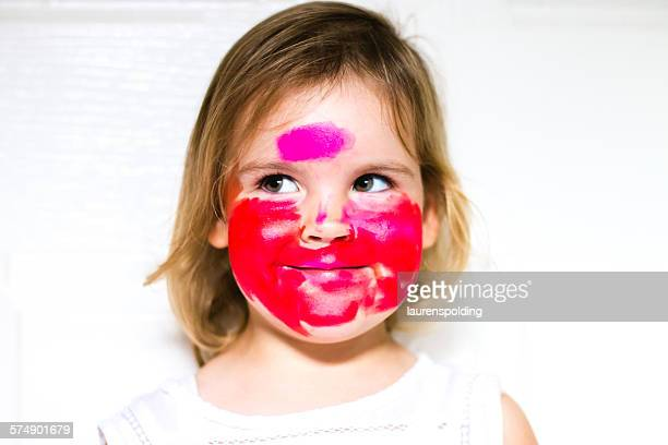 Portrait of a girl with lipstick all over her face