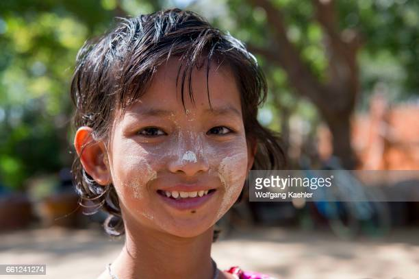 Portrait of a girl with paste made out of the Thanaka tree on her face providing protection from sunburn in Bagan Myanmar
