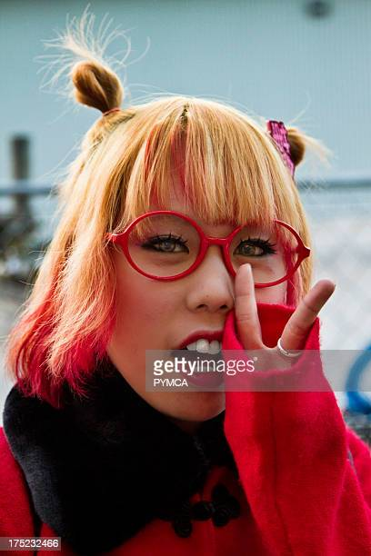 Portrait of a girl with red hair glasses and matching coat Tokyo 2010