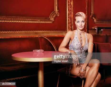Portrait of a Glamorous Ballroom Dancer Sitting at a Table in a Night Club