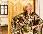 Portrait of a Glamorous Senior Woman in a Silk Dressing Gown Standing With Her Hands on Her Hips