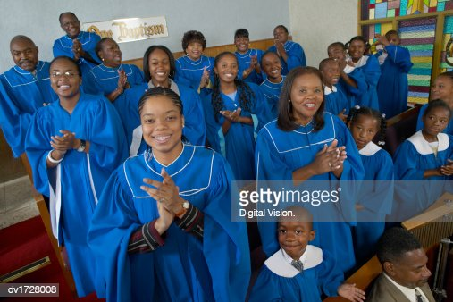 Portrait of a Gospel Choir Clapping Their Hands in a Gospel Service : Stock Photo