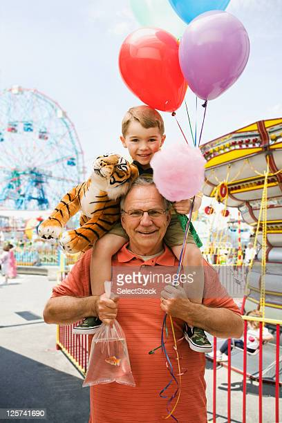 Portrait of a Grandfather and Grandson in a Fair