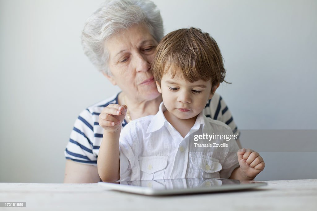 Portrait of a grandmother with her grandson lookin : Stock Photo