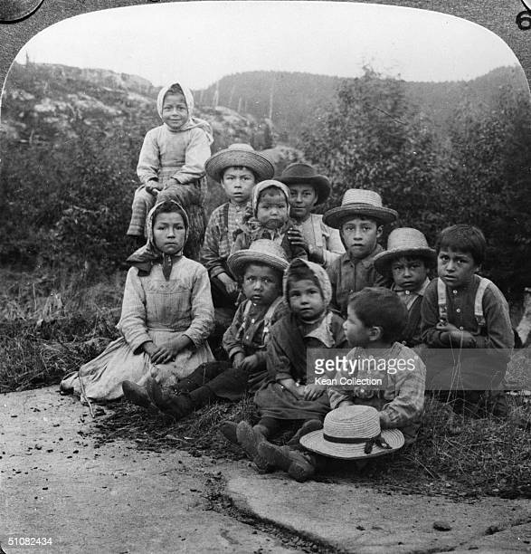 Portrait of a group of children from either the Chippewa or Ojibway tribe posing outdoors at Port Caldwell Ontario Canada 1890s