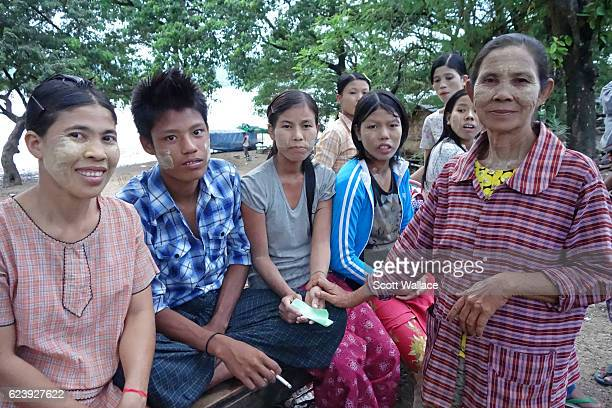 Portrait of a group of day laborers as they wait for public transportation after a day of work near the Irrawaddy River Pyay Myanmar 2013 They all...