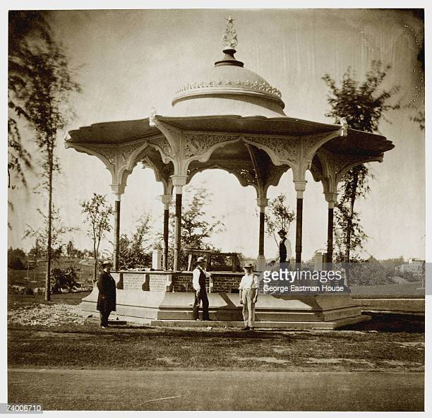 Portrait of a group of men various tools in their hands as they stand on and near a mostly contructed pavillion in Central Park New York New York...