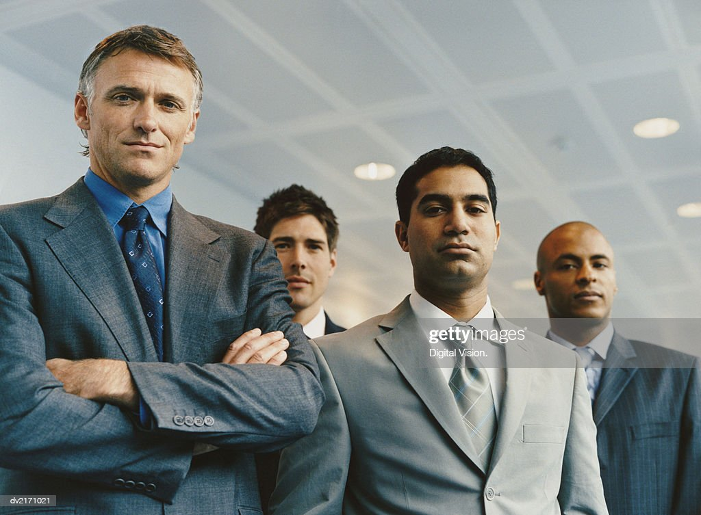 Portrait of a Group of Serious Businessmen : Stock Photo