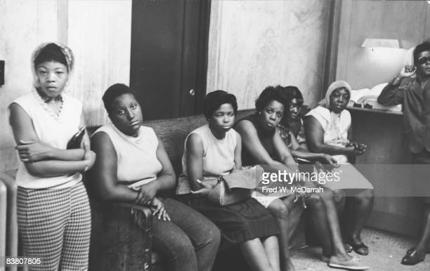 Portrait of a group of women in a police station as they wait to pick up relatives picked up by police for looting during riots Newark New Jersey...