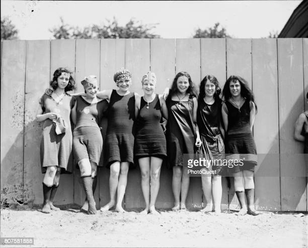 Portrait of a group of young women as they pose in risque bathing suits that bare the legs and knees Washington DC May 29 1920