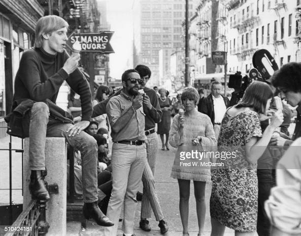 Portrait of a group on the south side of St Marks Place during the filming of a movie by photographer Barry Feinstein New York New York August 13 1966