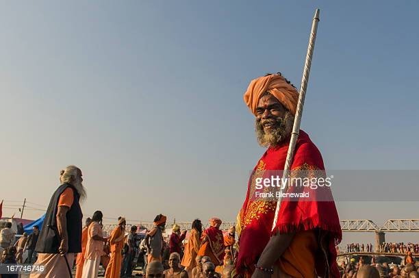 Portrait of a guru guiding the initiation of new sadhus at the Sangam the confluence of the rivers Ganges Yamuna and Saraswati at Kumbha Mela