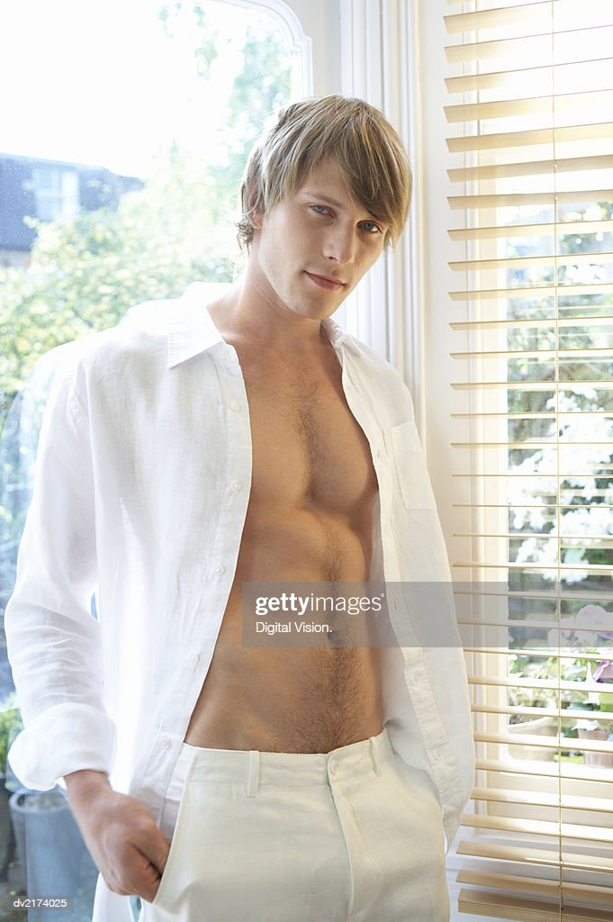 Portrait of a Half Dressed Young Man : Stock Photo